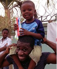 Kwame Otuo-Achampong with a smiling young friend in Ghana.